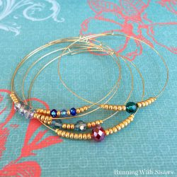 Make these Delicate Beaded Bangles using memory wire, crimp beads, and pretty crystal beads. We'll show you how with a video tutorial!