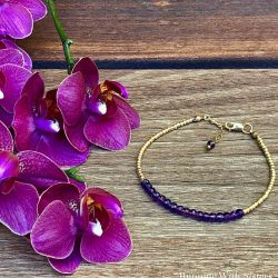Make A Birthstone Friendship Bracelet with delicate gold beads and real gemstones. We'll share how to put the bracelet together plus how to add a chain to the clasp to make the bracelet adjustable.