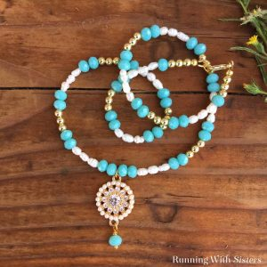Make a gorgeous Pearl And Turquoise Beaded Necklace featuring a pearl and rhinestone circle pendant. We made a complete video tutorial to show you how!