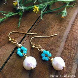 Make a pair of elegant turquoise pearl earrings. These pretty earrings feature a loop of turquoise seed beads and a freshwater pearl. We'll show you every step so you can make your own!
