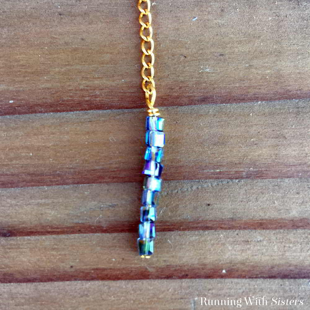 Make a gorgeous Crystal Bar Lariat Necklace. This delicate necklace needs no clasp. So it's easy to make and wear! We'll show you how!