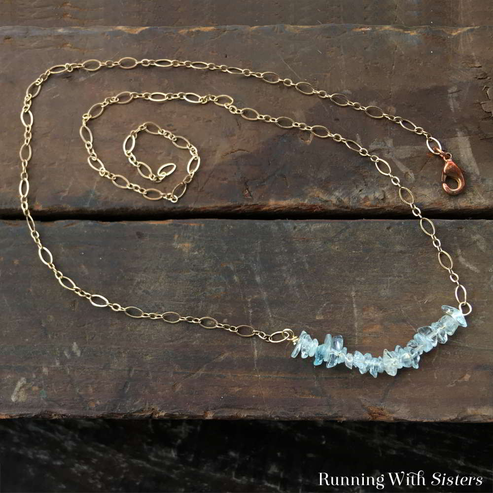 This Dainty Aquamarine Necklace is made with a little wirework and two pieces of chain. We'll show you how to make the central bar using gemstone chips.
