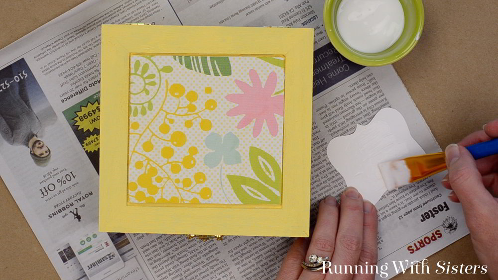 Make a DIY Jewelry Box. We'll share a downloadable label that says Blingy Things, then show you how to decoupage it onto a wood box to make a jewelry box.