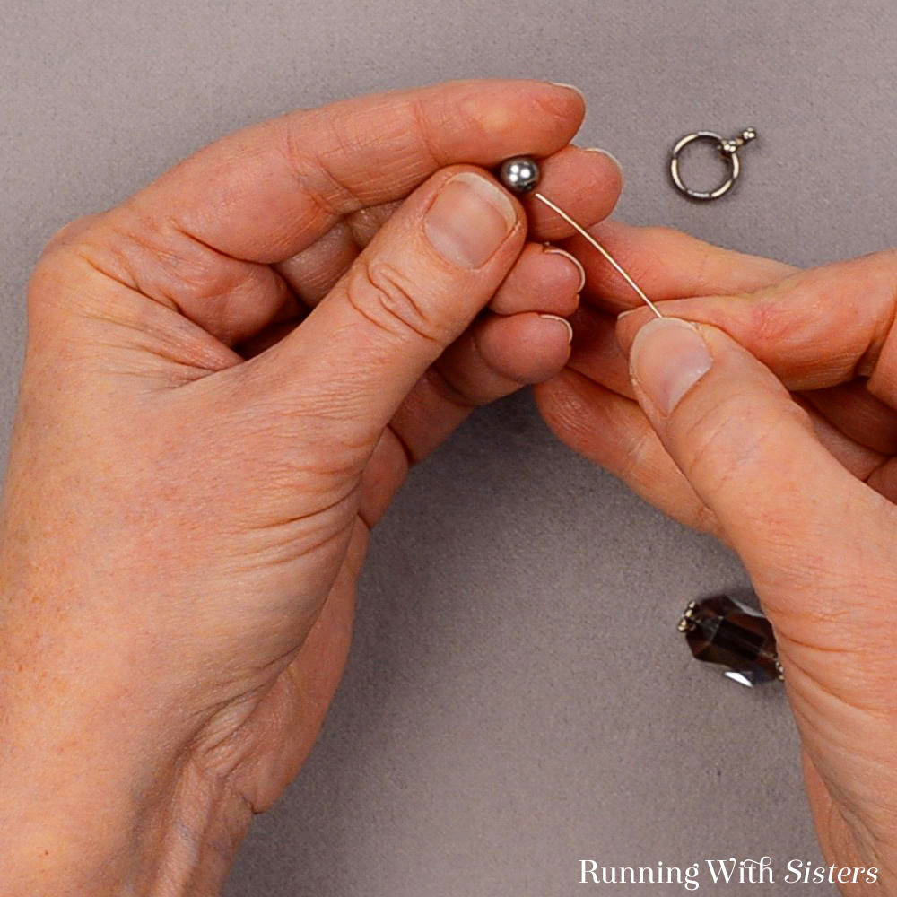 Learn to make a Long Crystal Necklace with this jewelry tutorial. We'll show you how to turn the bead into a pendant and attach it to the toggle clasp.