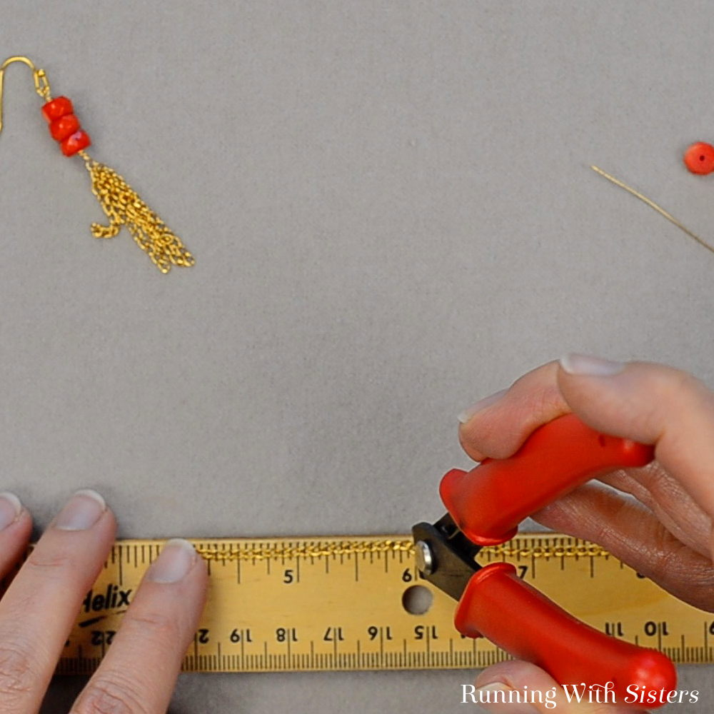 1 Coral Chain Tassel Earrings - Measure Two Inches Of Chain Make a pair of pretty Coral Chain Tassel Earrings. We'll show you how to make a chain tassel and attach it to the coral beads. Video included!