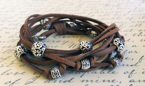 Learn to make a Boho Leather Wrap Bracelet using silver beads and sueded leather cord. We'll show you every step in this complete online video class.