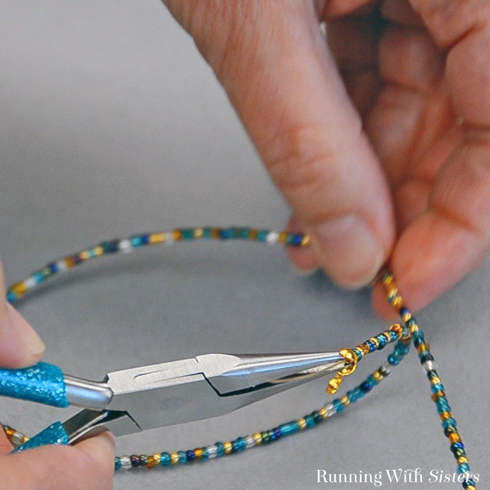 Multi Strand Necklace - Flatten Crimp Bead In Clamshell Bead Tip